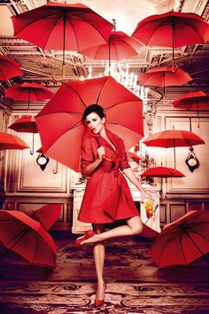 Penelope Cruz dazzels in gorgeous rich red fashions for the latest Campari Calender, photographed by Kristian Schuller