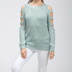 FINAL PRICEMetallic sweater top Very classy, this is one of the best sweater tops you will ever own. It's a greenish color with silver metallic strands.                                                                                            65% poly, 35% metallic. Available in Small and medium. Large is sold out Boutique Sweaters