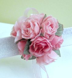 This classic bridal wrist corsage or prom wristlet made from pink sweetheart roses, real to the touch silk wedding flowers. $15.00