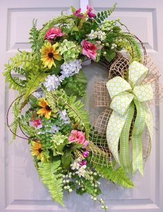 Simple elegance fills this flower and fern wreath with designer quality florals. Yellow sun daisies, white/green hydrangeas and blush roses are mixed with two different kinds of ferns, berries, and lo