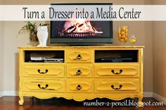 A TV stand from an old dresser.  Take out two drawers for the DVD/CD player.  Love this idea.