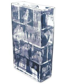 """""""Glass Photo Vase"""" -can easily be DIYed by decoupaging photos onto any glass vase & spray with seal. Print photos on vellum for more translucent effect; can also be used as a candle holder so images are lit up."""