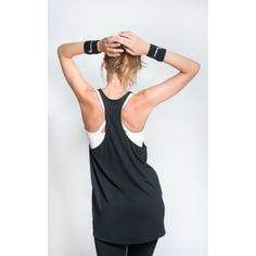 Sportsvest with draped look in black and 3/4 length cut and racer-back design worn with logo print leggings and cream ivory cross-over sportsbra  #sportswear #activewear #leggings #sportsvest #sportsbra #yoga #pilates #workout #fitness #fashion #swallow