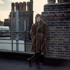 Mick Jagger on roof. Gered Mankowitz.