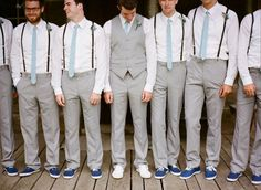 Groomsmen= Suspenders (maybe Vest or Sweater Vest)     Groom= Vest (maybe Jacket or Sweater)    but ALL Khaki Pants