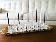 How great is this simple DIY Hanukkah menorah made from salt shakers? If you don't have enough  around the house look for some at thrift stores!