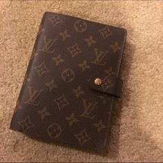 Louis Vuitton 6 ring Planner Gently used Louis Vuitton 6 ring planner. Comes with a few LV note sheets, page marker/ruler, and 2 sheets of LV stickers. Louis Vuitton Accessories Key & Card Holders