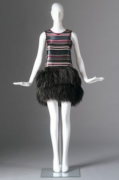 """Dress, Geoffrey Beene (American, 1927-2004): 1968, silk chiffon, sequins, ostrich feathers. """"The sense of movement, which was a design credo for Beene throughout his career is evident in this evening dress designed for The Supremes. The famous full-length sequined football jersey dress is from the same collection. Beene was among the first to introduce these casual references into evening wear."""""""