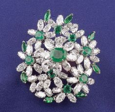 Platinum, Emerald and Diamond Pendant/Brooch, Oscar Heyman, prong-set with oval and marquise-cut diamonds weighing 16.00 cts., and oval, round, and marquise-cut emeralds weighing 3.00 cts