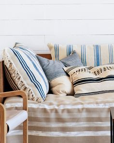 Nautical stripes in faded blues combine with neutrals and naturals for a room that's modern and inviting. We used the same rugs to make two kinds of pillows: a large one (bigger than a bed pillow) and a smaller one with an envelope-style opening.