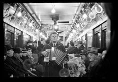 Walker Evans  _  February 1938 _ View Down Subway Car with Accordionist Performing in Aisle, New York City _ _ _ Walker Evans Archive, The Metropolitan Museum of Art