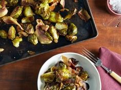 Balsamic-Roasted Brussels Sprouts Recipe | Ina Garten | Food Network *cooked 35 min and last 15 min increased temp to 450 to get crispy. Used TJ's balsamic glaze and TJ's turkey bacon - came out great!