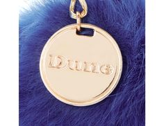 Perk up your accessories with this bright faux fur pom pom keyring. Featuring a lobster clasp attachment and metallic Dune branded charm. Pop it onto a shoulder strap or link to add fuzz appeal your accessories.