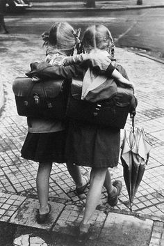 two schoolgirls walking and embracing   © dr. paul wolff & alfred tritschler