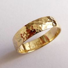 Gold mens wedding band wedding ring 5mm wide hammered for men and women yellow domed traditional. $350.00, via Etsy.