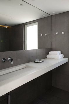 Large contemporary mirror and modern design bathroom decoration with white sink