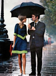 A stylish couple in the rain in London (1963). The Dress.