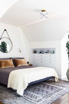 Lauren Geremia gave this San Francisco house a modern makeover. The attic was converted into a master suite where BDDW's Captain's mirror takes the place of a headboard | archdigest.com