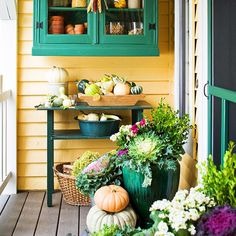 Group some roly-poly gourds to achieve this simple fall decor: http://www.bhg.com/halloween/outdoor-decorations/pretty-front-entry-decorating-ideas-for-fall/?socsrc=bhgpin093014gourddecor&page=28