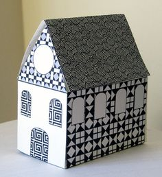 Free printable black and white paper house from Print Cut Paste Craft. Nice house warming party favour, gift box or decoration.