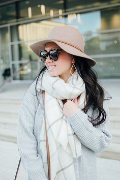 tan floppy hat and white scarf
