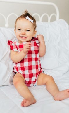 These baby rompers are a nod to the past; with a classic romper cut and criss cross back.  The darling bow and gingham print puts it over the top.