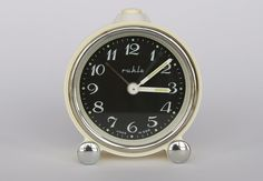 Vintage German mechanical alarm clock from Ruhla. Cream with black face. East Germany. Made in GDR.