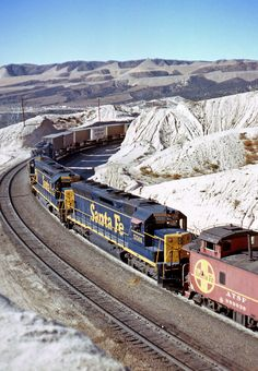 """The e/b """"LAF"""" helps the e/b Harbor Train into Summit, CA on Nov. 1, 1970. Three SD45's and a lone SD24 provide the oomph!"""