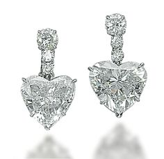 A PAIR OF DIAMOND EARRINGS, BY HARRY WINSTON   The two heart-shaped diamonds, weighing approximately 7.69 and 6.06 carats, each with a brilliant-cut diamond surmount and top, mounted in platinum and gold, 2.6 cm  With maker's mark of Jacques Timey for Harry Winston