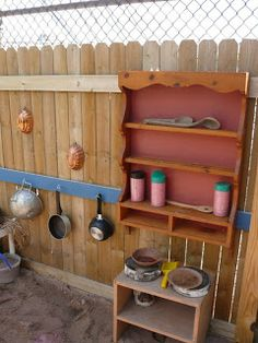 Mud Pie Kitchen. Love the idea of using the fence as added storage. Just what we need in our yard!