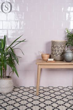 An inspiring combination of subtle, glossy pink field tiles and patterned Persian flooring. Floor tiles from the Odyssey range by Original Style, wall tiles by The Winchester Tile Company. These work very well when paired with warm, natural textures and materials such as wood. Make the pink tiles stand out by contrasting them with greenery.