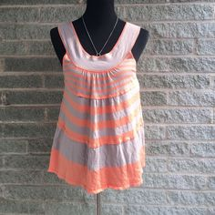 Free people striped tank Light wear no stains or tears orange and tan color Free People Tops Tank Tops