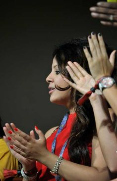 Sakshi, wife of Chennai Super Kings captain M.S. Dhoni applauds the victory of her spouse's team against Mumbai Indians during the IPL Twenty20 cricket 2nd Playoff match at the M. Chinnaswamy Stadium in Bangalore on May 23, 2012.