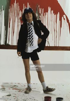 Guitarist Angus Young of Australian rock band AC/DC poses in London, England in August 1979.