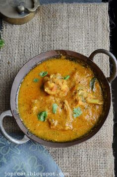 Spicy Chicken Kuzhambu Chicken & Coconut Milk Curry, a spicy yet rich and aromatic chicken curry made using pressure cooker. Marinated chicken is cooked wit