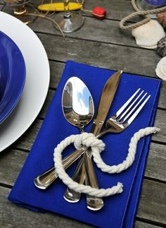 Royal blue linen napkins with tied rope. You can find the napkins at http://cjs-ocean-wedding-rental.myshopify.com/