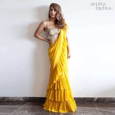 Yellow ruffles saree with ivory embroidered saree blouse. #Frugal2Fab