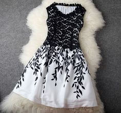 http://www.bygoods.com/new-elegant-leaves-embroidered-stitching-lace-party-dress-dress.html