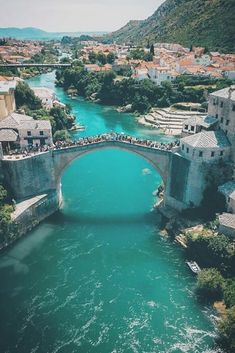 How many people do you think can fit on a bridge? The Old Bridge in Mostar, Bosnia and Herzegovina. Photo by Callum Thompson Places Around The World, The Places Youll Go, Places To See, Around The Worlds, Bósnia E Herzegovina, Places To Travel, Travel Destinations, Europe Places, Europe Europe