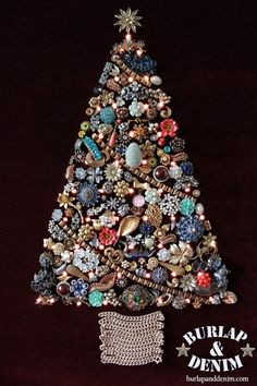 As a child I remember gazing upon my grandmothers costume jewelry Christmas tree. It was so shiny and the Christmas lights made it mezmorizing. My grandmother was very crafty, she made hers at a church activity. This was a popular craft back in the 1970s.  There was a magazine produced with instructions back then!(here is anexcerpt)Check out that tree, wait the hair is what is really amazing