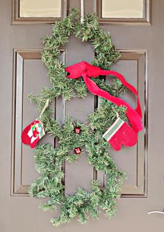 Snowman Christmas Wreath Craft For Your Holiday Door - kindredlive.com  Easy dollar store craft that is fun, cute, and cheap!  #Christmas