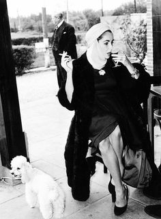 Elizabeth Taylor at Jersey Airport during a stop for interviews during her route to Nice photographed by Stanley Sherman, 1957.
