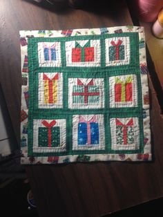 "Darla Kavanaugh - ""presents"" quilt; sold on ebay for $24.50"