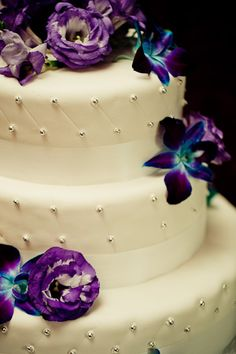 WEDDING CAKE:  Could choose more of the Royal Blue Orchids to pull out your colors.   Repined by Iowa City Florist, Every Bloomin' Thing