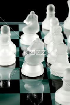 chess knights and pawns. - Close-up shot of crystal knights and pawns on chess board.