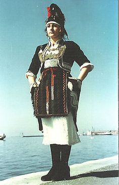 Greek-traditional-dress-Central-Macedonia-northern-Greece- The most striking feature of this costume is the unusual headdress (katsouli).