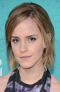 Emma looks beautiful with her simple, short hair.