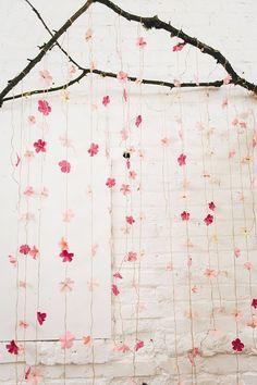 DIY wedding backdrop - photo by Jenn Byrne Creative http://ruffledblog.com/diy-paper-cherry-blossom-backdrop