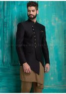 <p>This unique overlapping styled jodhpuri in solid black color is made out of poly silk fabric. It is crafted with a mandarin collar, left welt chest pocket, waist flap pockets and attractive buttons. It is complemented with light brown kurta, churidar and a matching pocket square making an entire 4-pc jodhpuri perfect for traditional occasions.</p> <p><span>Mojari shown in the image is only for photography purpose.</span></p>