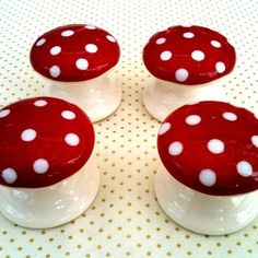 Adorable ceramic toadstool drawer pulls. I may have to make some with painted wood for the caravan!